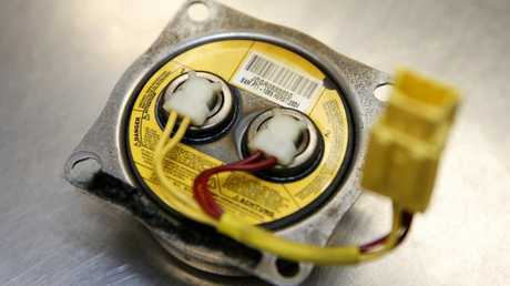A Takata airbag inflator after it was removed during a recall service. Picture: Jeff Kowalsky