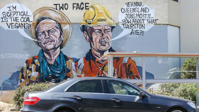 Graffiti in the Batman electorate reveals public sentiment in the inner-city suburbs about Adani. Picture: Ian Currie