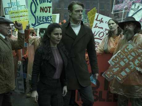 Martha Higareda and Joel Kinnaman get down and dirty in the underbelly of a dystopian society.