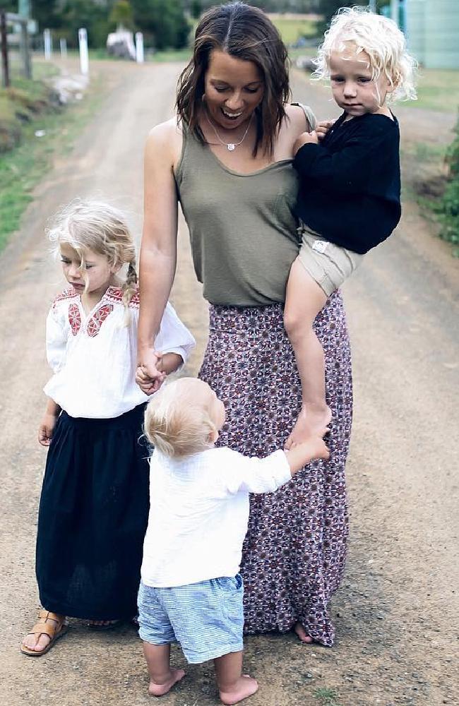 Anna Davis, with her three children, Alby, Sage and Acre.