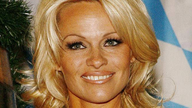 Pamela Anderson has revealed she complained to Hugh Hefner about men in Hollywood pressuring her for sex.