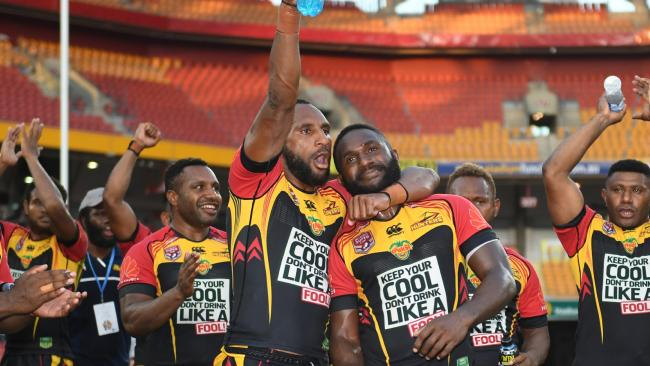 PNG Hunters players celebrate their Queensland Cup title.