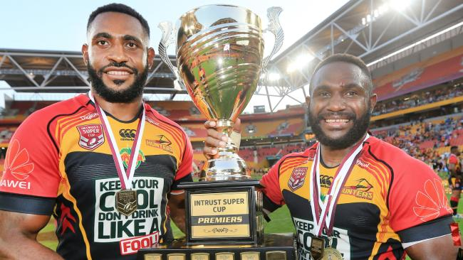 PNG Hunters players hold aloft the Queensland Cup trophy.