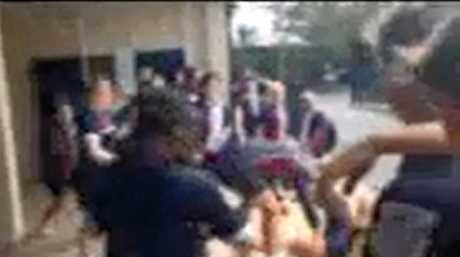Screen grabs from a video taken when Aniek Aardoom was thrown down a flight of stairs at Mackay State High School