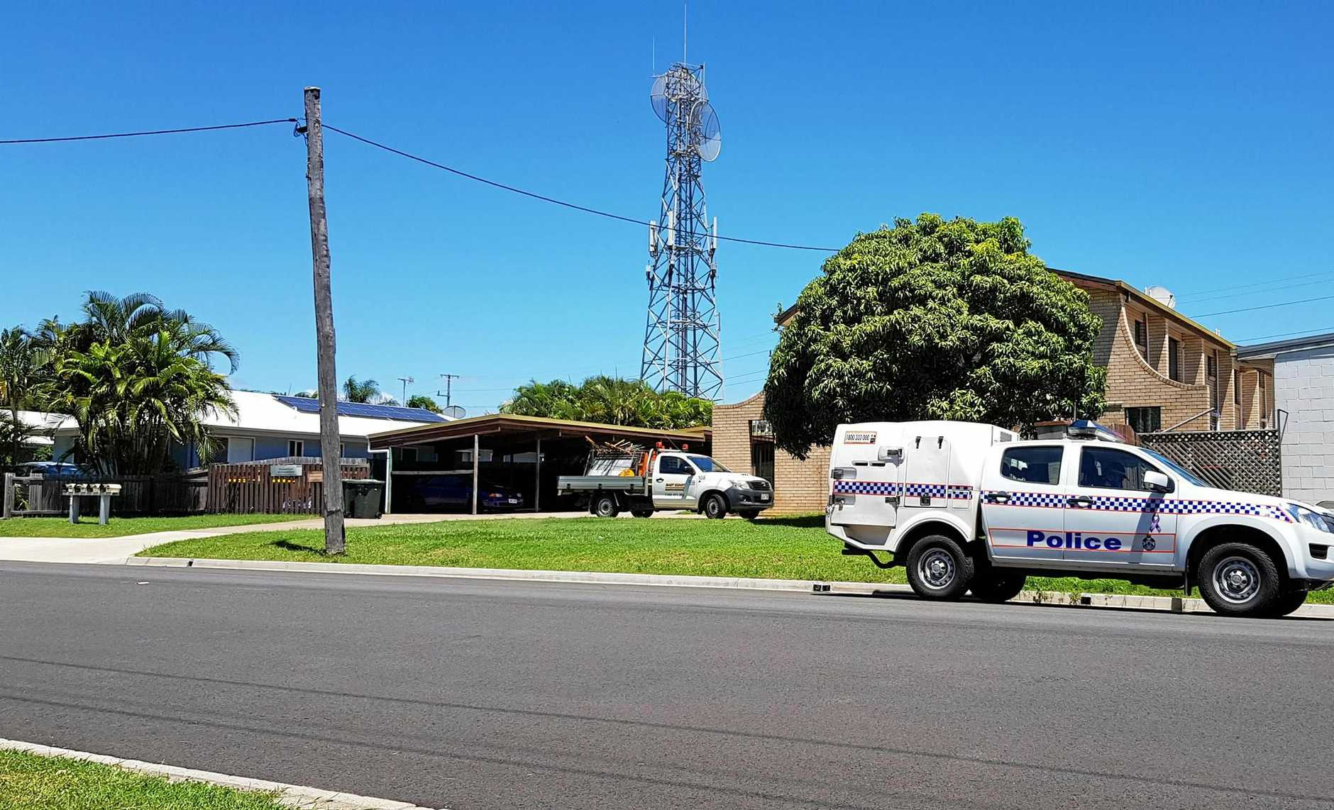 POLE POSITION: A police wagon sits outside the apartment complex at Barney Point.