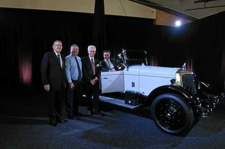 IMPRESSIVE: Paul Neville, Jack Dempsey, Lex Rowland and David Littleproud surround Burt Hinkler's restored Armstrong Siddeley at the Civic Centre this morning.