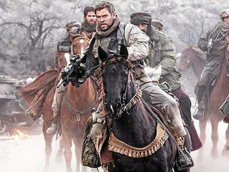 Chris Hemsworth shows off his impressive action credentials in 12 Strong.