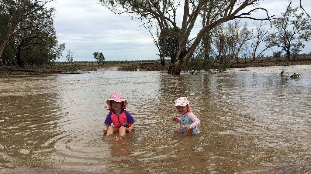 Lara Abel, 4, and Harriet Abel, 18mths, happily playing in water after 64mm of rain fell at Highfields, south west of Tambo