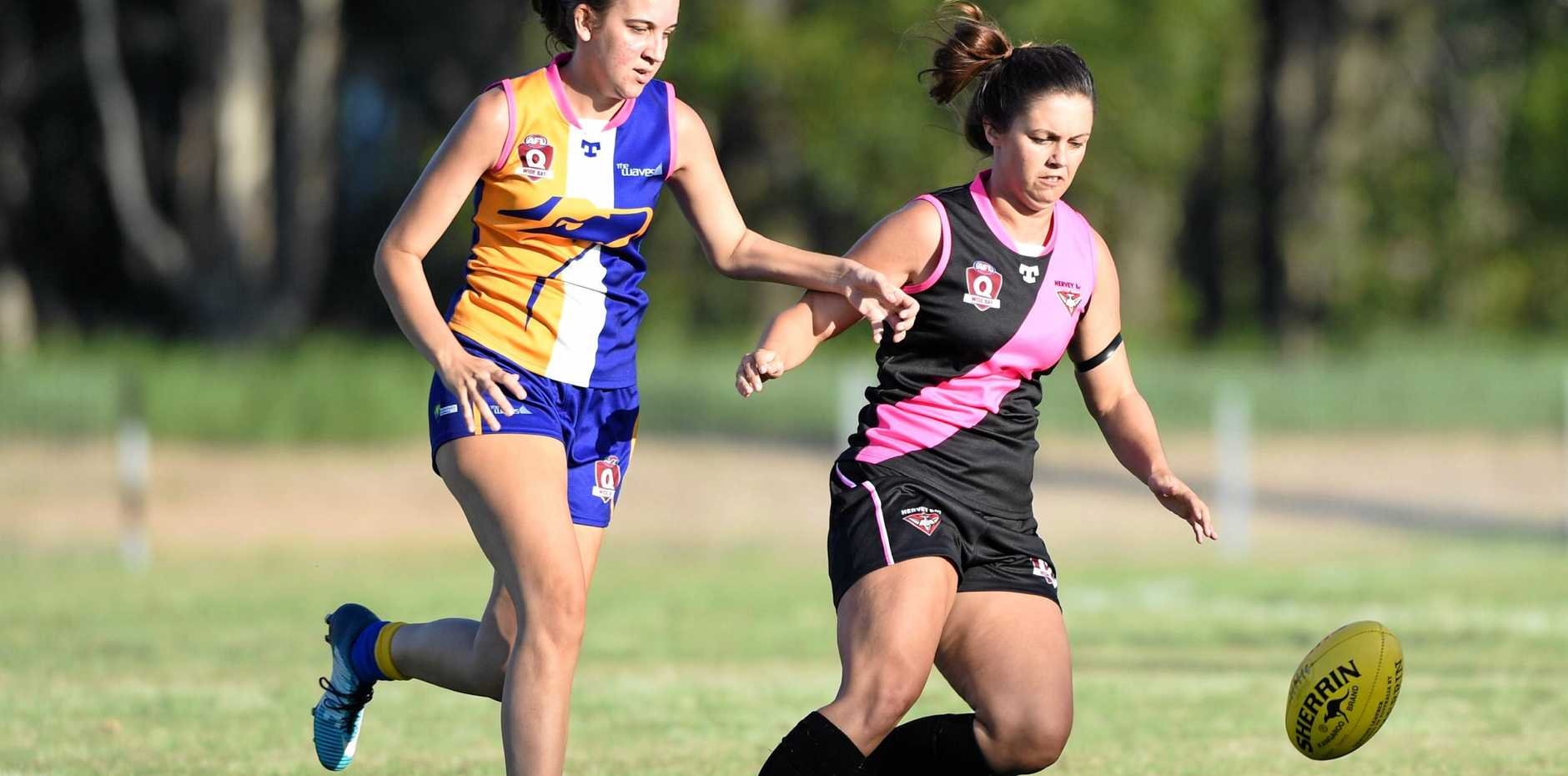 ANOTHER WIN: Sophie O'Toole tries to reclaim possession for Hervey Bay Bombers in Saturday's 60-point win against The Waves Eagles.
