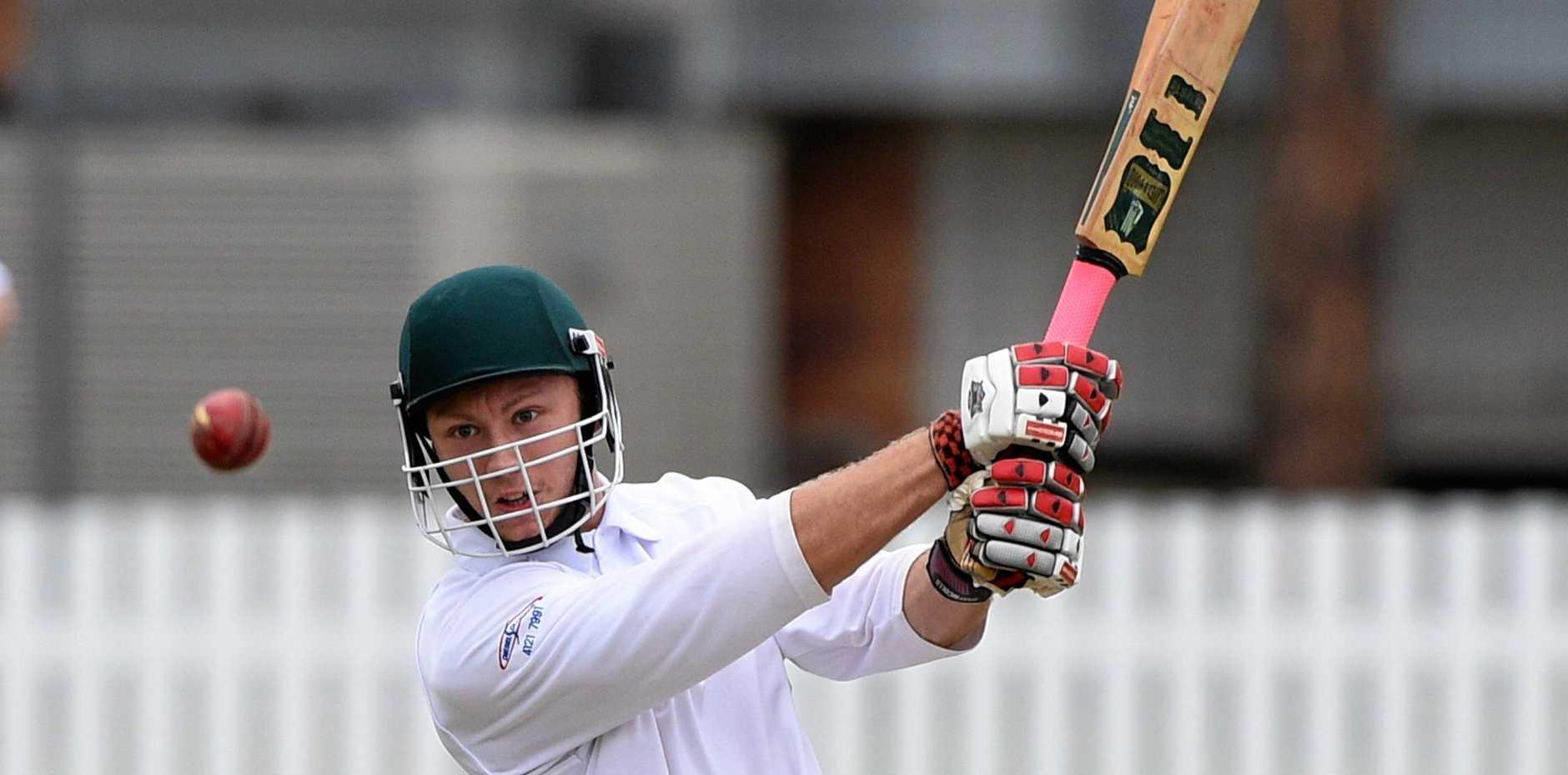 Maryborough cricket - Tinana (batting) v Australs (fielding). Tyler Simpson hits back down the field.