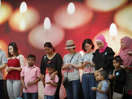 Relatives of passengers of MH370 have a moment of silence during the Day of Remembrance event in Kuala Lumpur. Picture: AP Photo/Vincent Thian)
