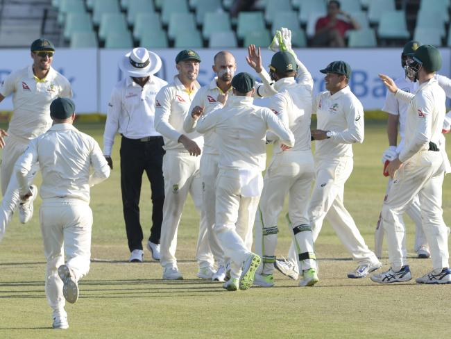 Nathan Lyon of Australia with his team mates in Durban.