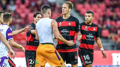 Liam Reddy confronts Wanderers players after his sending off.