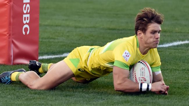 Tom Lucas of Australia dives over for a try against Spain in Las Vegas.