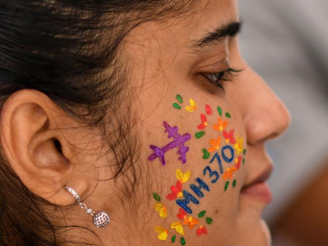 A woman at a memorial event for flight MH370 on March 3, 2018 ahead of the fourth anniversary of the plane's disappearance. Picture: AFP Photo