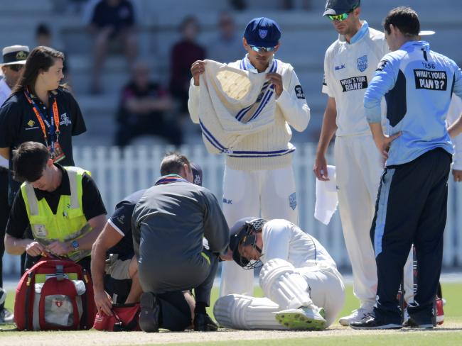 Will Pucovski of Victoria is taken off injured after getting hit by the ball