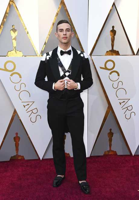 Adam Rippon arrives at the Oscars on Sunday, March 4, 2018, at the Dolby Theatre in Los Angeles.