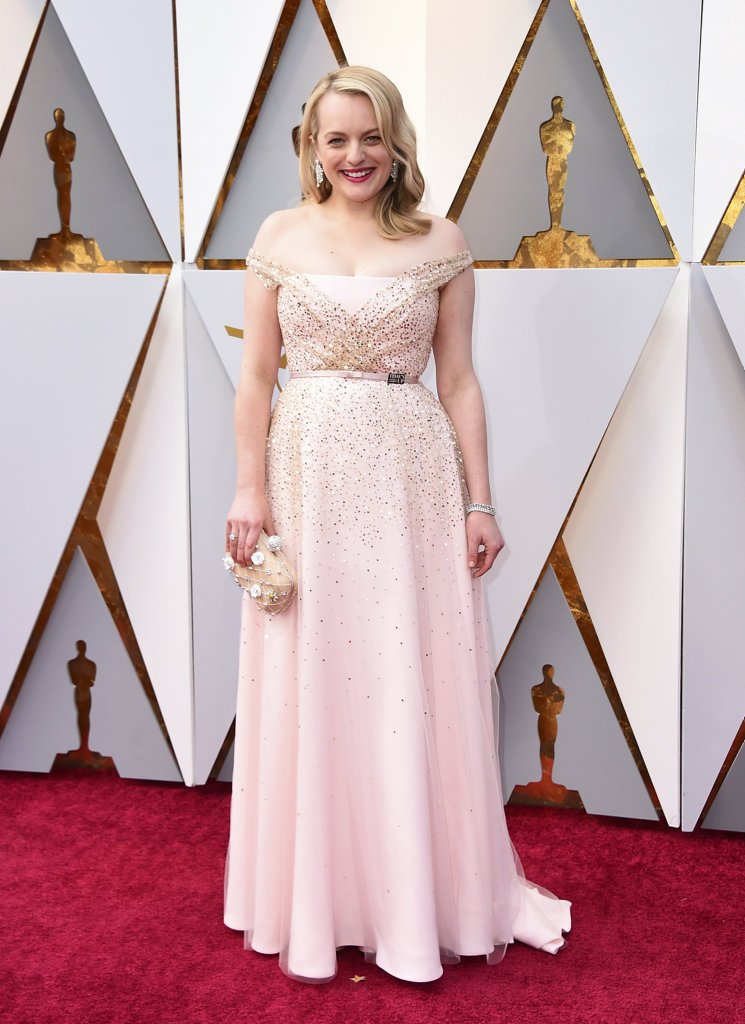Elisabeth Moss arrives at the Oscars on Sunday, March 4, 2018, at the Dolby Theatre in Los Angeles.