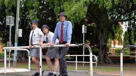 PEDESTRIAN TROUBLES: Maryborough State High School captains Bethany Robinson and Jemma Tennant with deputy principal Marty Mills at the school's Kent St crossing. Jemma is calling on the council to help fix the crossing to improve pedestrian safety for more than 700 students who use the crossing daily.
