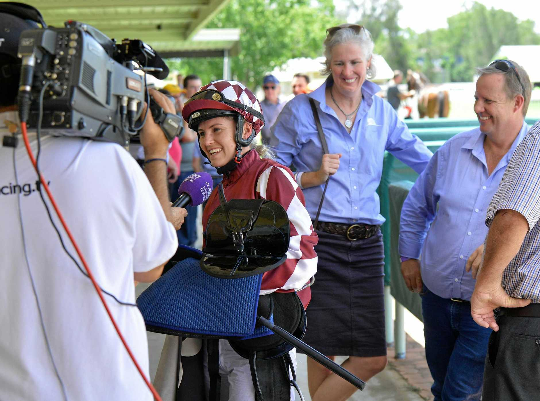 HAPPY MOMENT: Jockey Emma Ljung is the centre of attention after riding Aileach to victory in Ipswich.