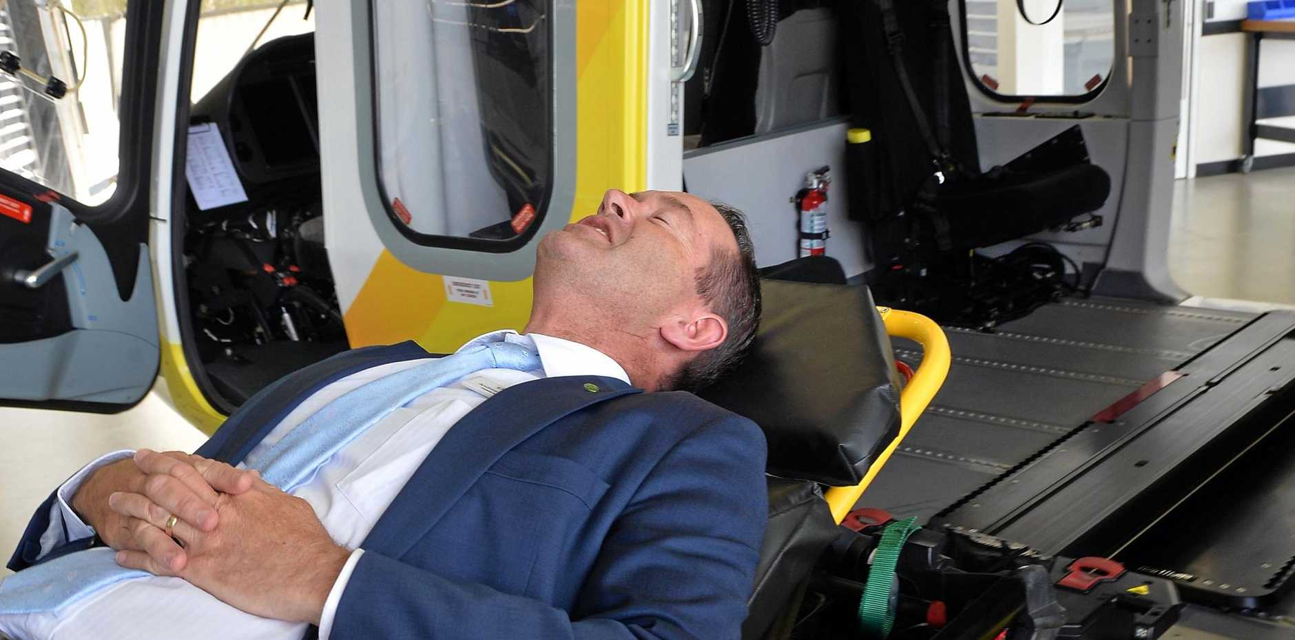 FISHER MP Andrew Wallace testing an automated stretcher system developed by Helimods at Caloundra which is now supplying the defence sector.