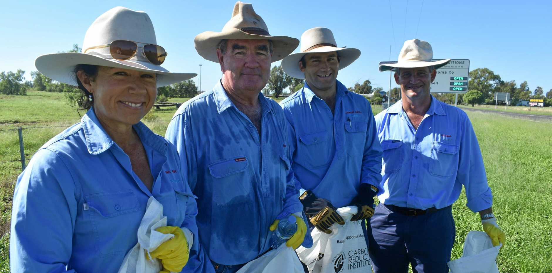 DIRTY WORK: Santos employees, Anna Ahern, Jon Warby, Andrew Hacker and Jim Sands pitch in for Clean Up Australia Day.