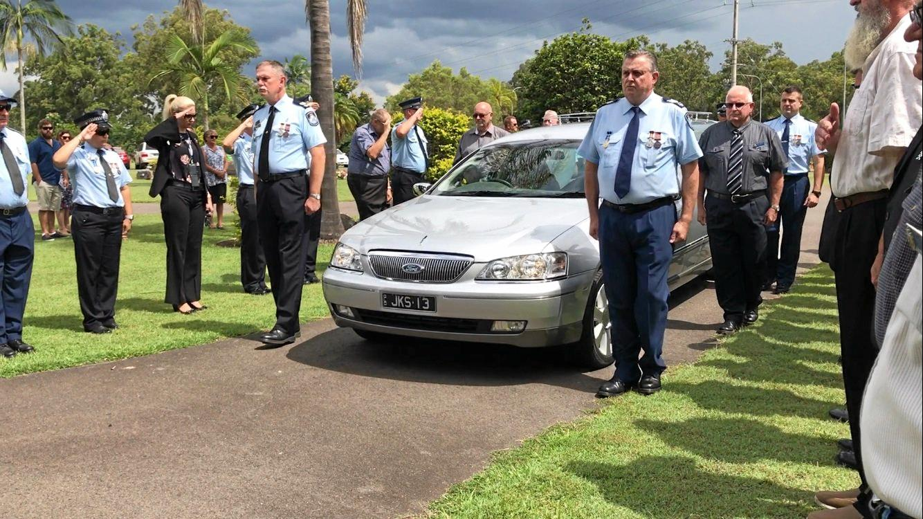 FAREWELL: A guard of honour was formed by police officers at Mal Churchill's funeral today.