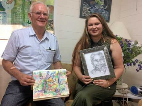 Dalveen artist Lyra Parker (left) with father Neville Heywood at the launch of Scenes of the Southern Downs art book, with the work they created for the book.