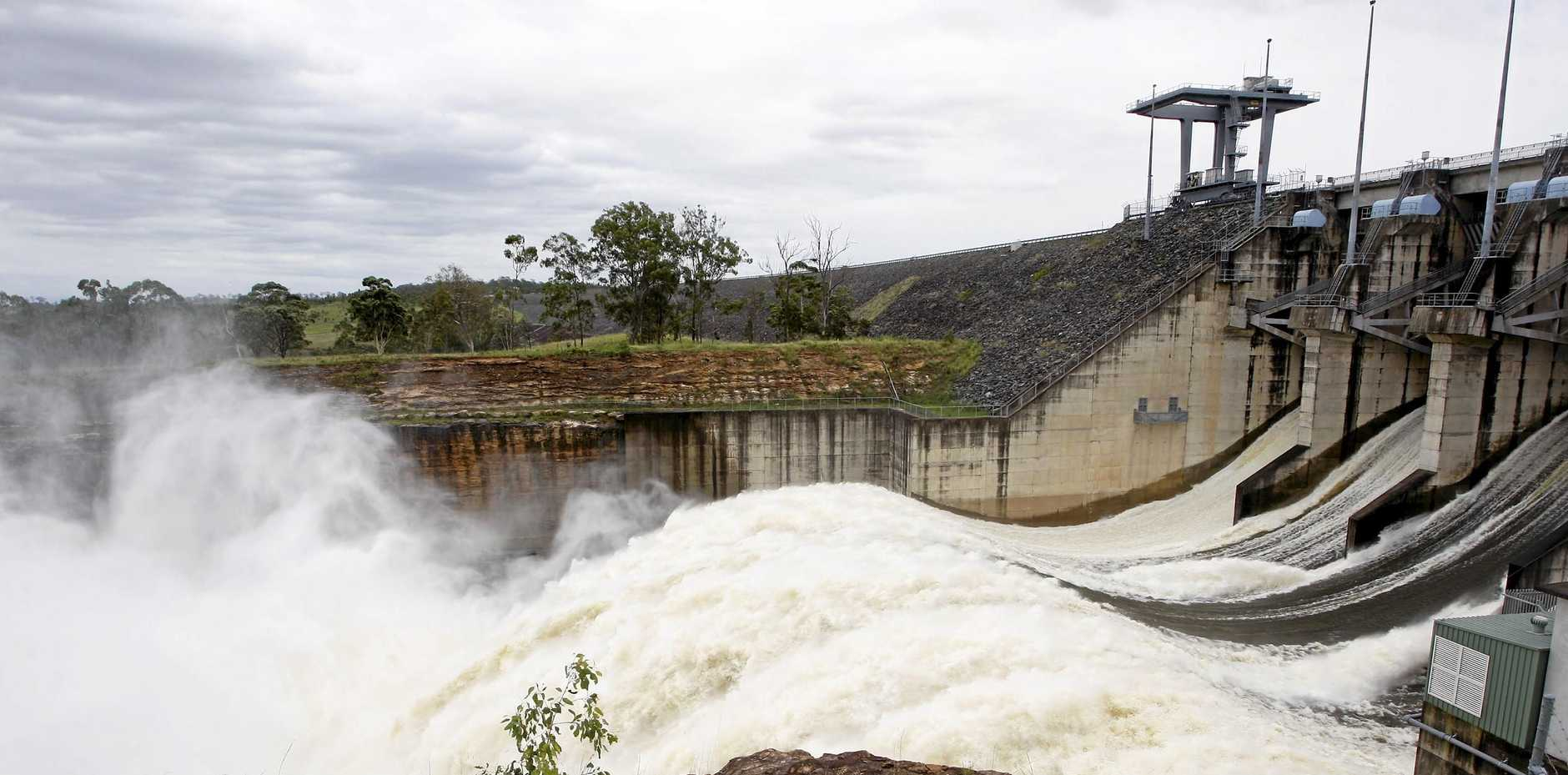 All five spillway gates open at Wivenhoe Dam creating a giant cloud of water spray.