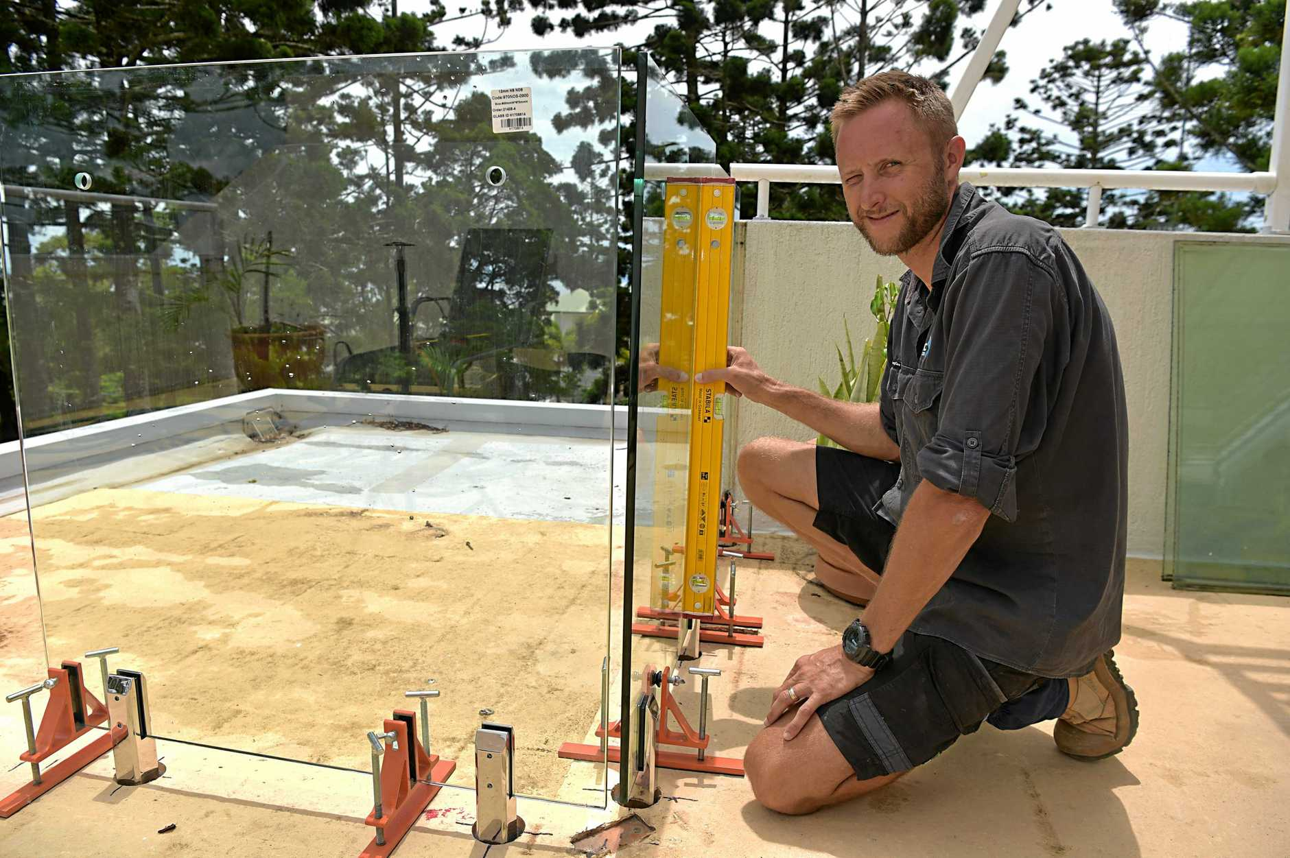 Coast pool fence and balustrade installer Luke Anstiss of Fab Tec has invented a tool that cuts the time to install glass fencing by two thirds. Hes using the product on a unit complex