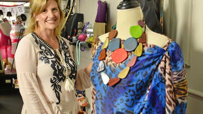 GEARING UP: Janette Czernia of Obsession Shoes Boutique in the Top of Town with some of her new winter stock.
