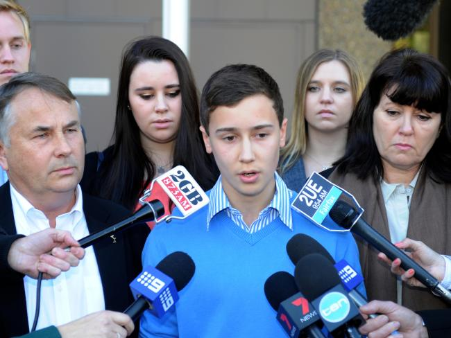 Stuart Kelly with parents Ralph and Kathy after Thomas's killer was sentenced. Picture: AAP