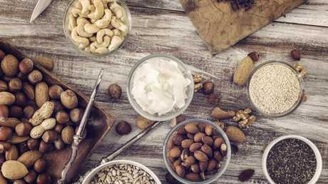 Coat half a cup of nuts with a teaspoon of vegetable oil, spread evenly on plate then microwave for one minute. Picture: iStock