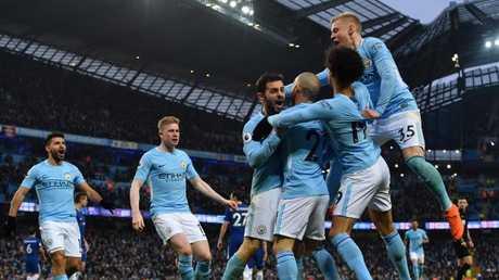 Manchester City's Portuguese midfielder Bernardo Silva (C) celebrates