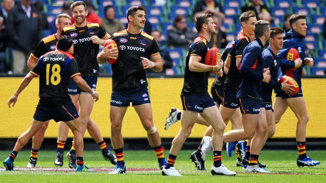 The Crows warm up before the 2017 Grand Final.