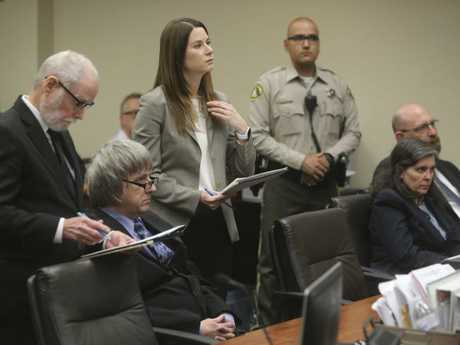Lawyers David Macher, left, and Allison Lowe, appear with their clients David, second left, and Louise Turpin, in court on February 23. Picture: Watchara Phomicinda/The Press-Enterprise via AP