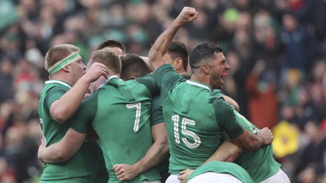 Rob Kearney, 15, celebrates Ireland's win over Wales.