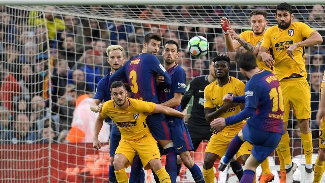 Barcelona's Argentinian forward Lionel Messi (R) scores