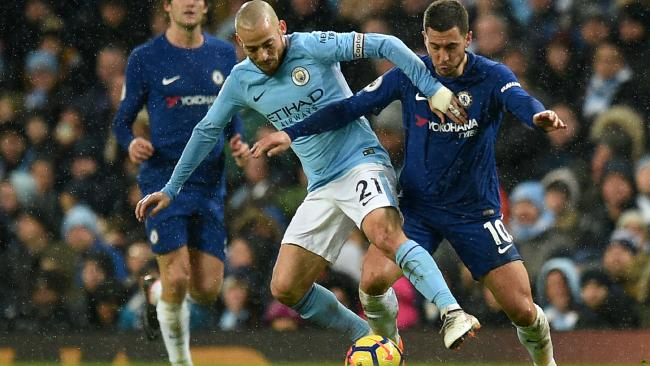 Manchester City's Spanish midfielder David Silva (L) vies with Chelsea's Belgian midfielder Eden Hazard