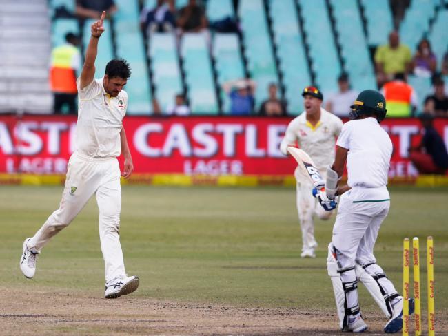 Australia's bowler Mitchell Starc (L) celebrates taking the wicket of South Africa's batsman Keshav Maharaj.