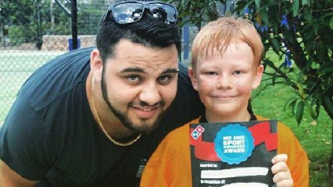 This little boy, who the Courier-Mail has chosen not to name but is pictured with his brother Murray Benton, is recovering in hospital after a suicide attempt following relentless bullying. (Pic: Supplied)
