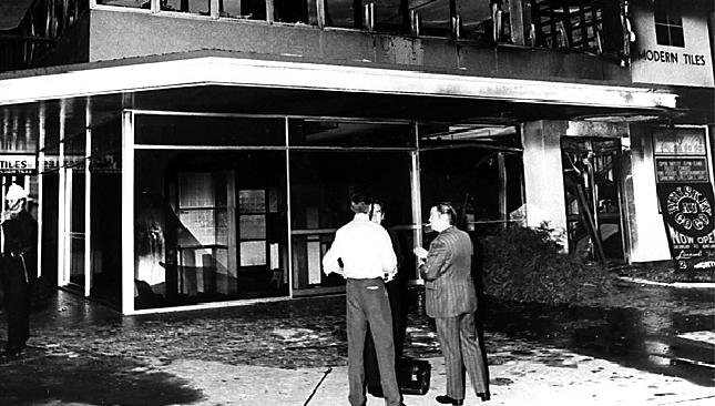 Police inspect the scene of the 1973 Whiskey Au Go Go fire.