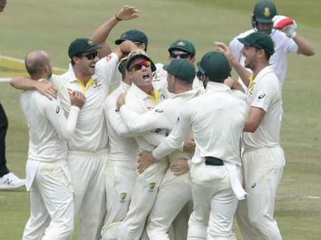 Australia celebrate the run out of AB de Villiers of the Proteas right.