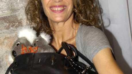 Singer Jane Birkin with her Hermes Birkin handbag.