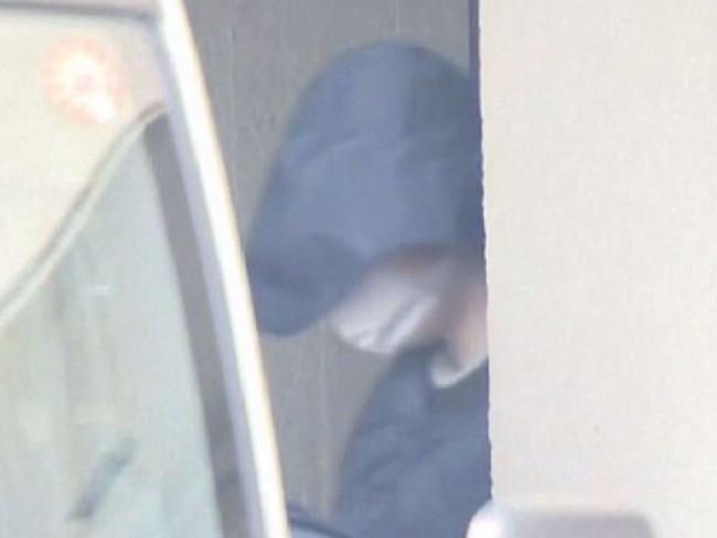 New York man Yevgeniy Vasilievich Bayraktar, 26, is seen hiding his face. Picture: NBC