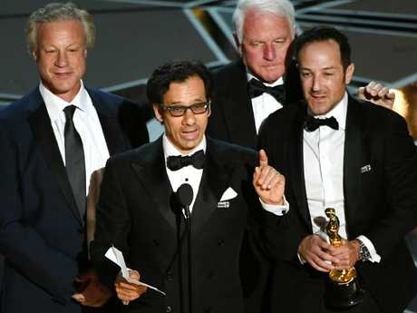Producer David Fialkow, director Dan Cogan, producer James R. Swartz, and director Bryan Fogel accept Best Documentary Feature for Icarus. Picture: Getty Images