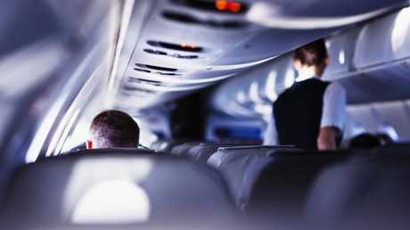 Cabin crew are in charge of serving drinks on flights — by law. Picture: