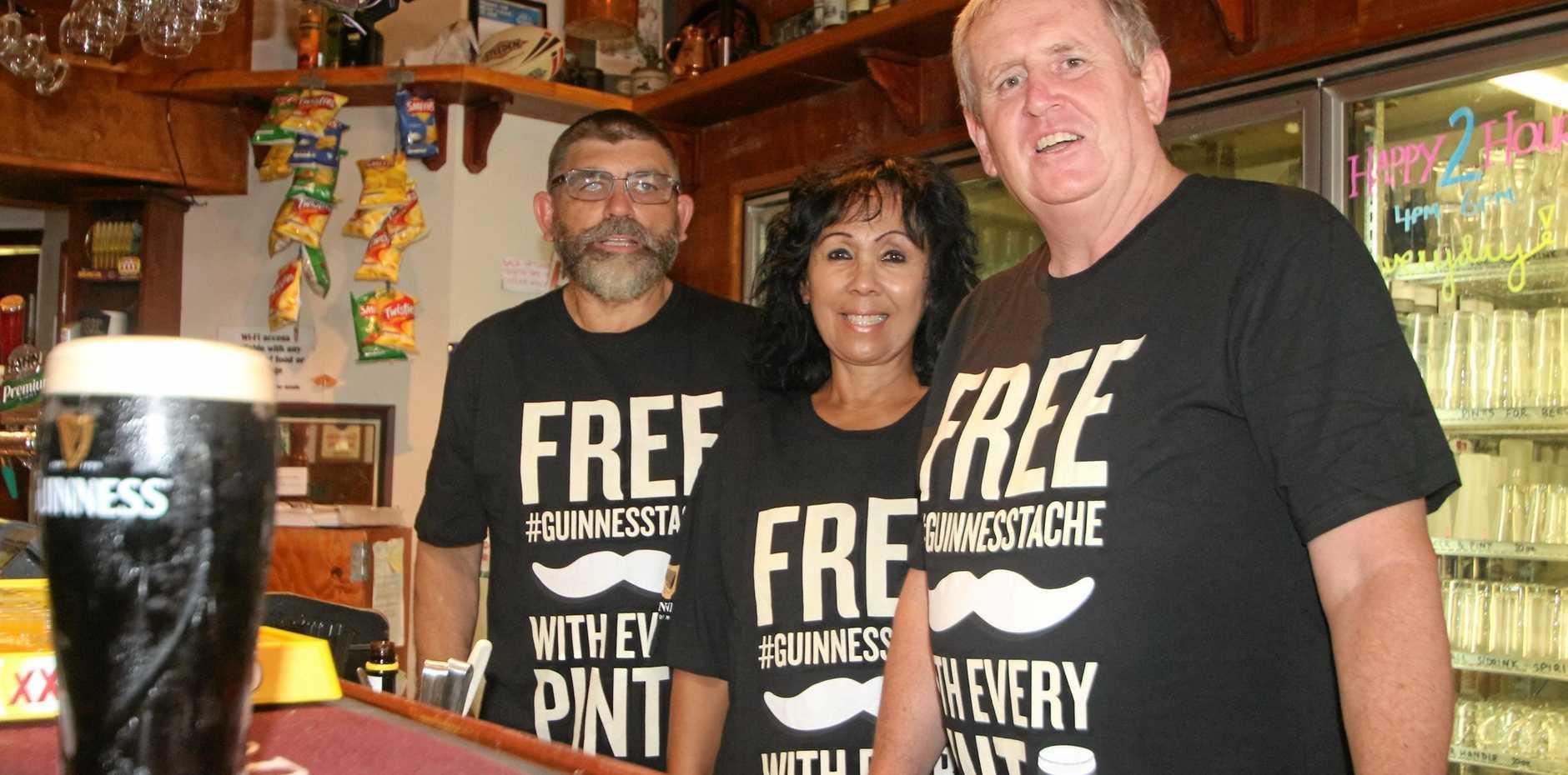 CHEERS: Paul Scott, Cheryl Royal-Scott and Patrick Barrett welcome you to a new era of dining at Hoolihans Irish Restaurant and Bar.