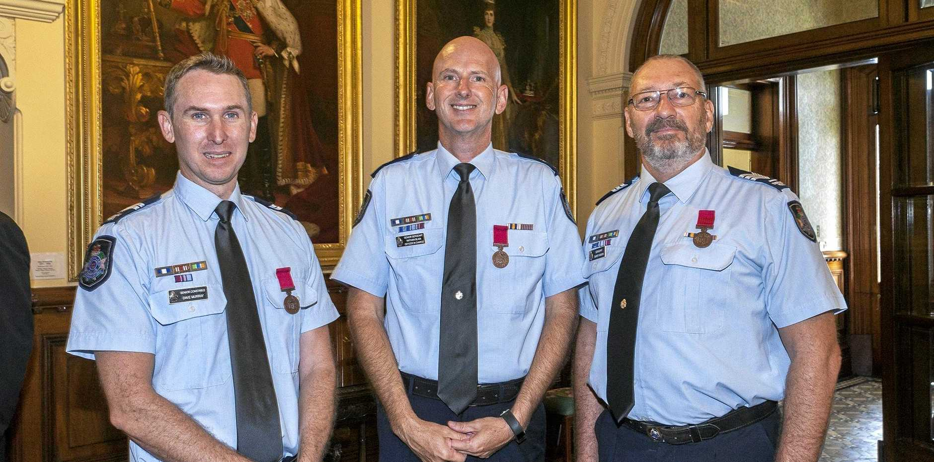 Dave Murray, Nathan Blain and Barry Haran have been honoured for their courage when a dangerous fire threatened the lives of several people.