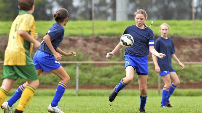 CLUB DEBUT: USQ FC Blue captain Ella Briggs controls the ball during her side's game against Highfields 13B at Toara Park. The weekend's matches were the first time USQ FC has provided junior team in the Toowoomba competition.